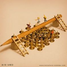 Thumbtack http://miniature-calendar.com/130213/. miniature photography - incredibly enchanting and surreal worlds made of little people - It's a small world afterall! Creative macro lens photography