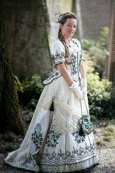 Victorian gown reproduction from 1873 silk and beetle wing embroidery. Costume made by Angela Mombers picture by Henk van Rijssen