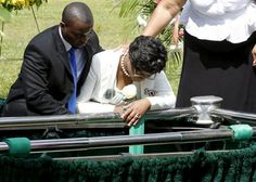 Texas county releases video to dispel rumors over woman's death. Pictured: Sharon Cooper (R), sister of Sandra Bland, kneels over the burial plot of her sister Sandra Bland during the funeral in the Chicago suburb of Willow Springs, Illinois, United States, July 25, 2015. REUTERS