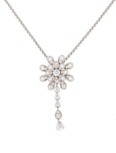 18K white gold Piaget rolo chain necklace with snowflake pendant featuring bezel and prong set diamonds throughout and lobster clasp closure.