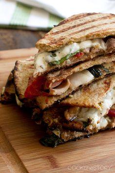 Grilled Chicken Panini with Greek Yogurt Pesto Spread via Cook the Story #savory #comfort