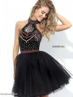 Sherri Hill 50707 is a short homecoming dress with a halter top and a tulle skirt.