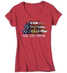 Women's V-Neck American Flag Sunflower T Shirt Peace Love Freedom Shirt Hippie Shirt Boho Shirt Patriot ShirtThis boho style tee is perfect for any patriotic holiday or just because America. It features a hand illustrated sunflower with vintage American flag within and a peace sign. It reads 'Peace. Love. Freedom.'. Perfect for the 4th of July, Memorial day, veteran's day and so many more. A beautiful tee to show off your love of America in. Soft ring spun cotton is machine wash and dry. Include Hippie Shirt, Patriotic Shirts, Hand Illustration, Boho Style, Peace And Love, American Flag, Spun Cotton, Boho Fashion, Freedom