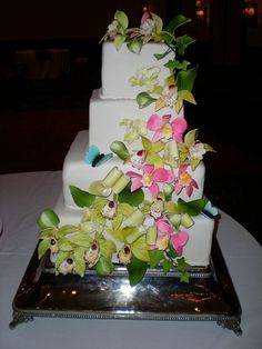 I like the way the flowers are positioned on this cake, they kind of cascade down the side.