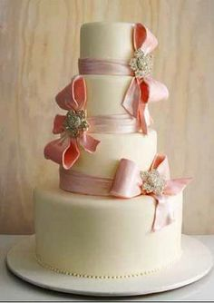 Pretty and romantic four tier pink and ivory wedding cake decorated with hand crafted pink fondant and large pink fondant bows with diamontee floral brooches in the centre of each of the bows. From The Cake Girls. Bow Wedding Cakes, Ivory Wedding Cake, Bella Wedding, Wedding Cake Decorations, Elegant Wedding Cakes, Perfect Wedding, Chic Wedding, Wedding Blog, Destination Wedding