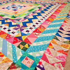 Medallion Quilt Rainbow Flying Geese Finished!, via Flickr.