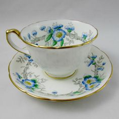 Beautiful tea cup and saucer set with blue flowers. Gold trimming on cup and saucer edges. This piece was made in England by Hammersley. Excellent condition (see photos). Markings read: Bone China Hammersley & Co Made in England Please bear in mind that these are vintage items and