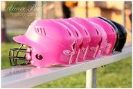 You and your friend having the only two black helmets out of the whole team because you think pink is to girly for softball