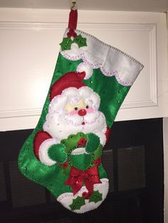 Santa & Wreath Completed Bucilla Felt Stocking - Free Personalization by HeirloomsByTina on Etsy https://www.etsy.com/listing/206909109/santa-wreath-completed-bucilla-felt