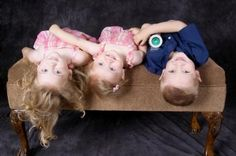 Kids upside down on bench