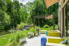 A terrace offers a front-row seat to the property's picturesque pond.