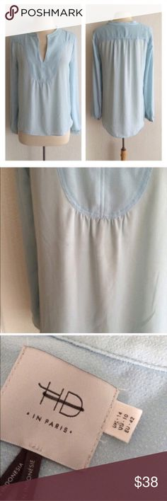 """HD in Paris Telma blouse HD in Paris Telma blouse. Size 10. High low style. Measures 24"""" long in front, 28"""" in back, and has a 40"""" bust. This has no stretch and is sheer. 100% polyester, but lightweight. This has a small smudge on the front- I am unsure of what it is (looks like pen/ pencil). Please see photos.                                                               🚫NO TRADES🚫 💲Reasonable offers accepted💲 💰Great bundle discounts💰 Anthropologie Tops Blouses"""