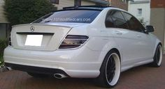 Modified Mercedes Benz C-Class (W204) C350 with custom painted white, rear body kit and smoked tail lights