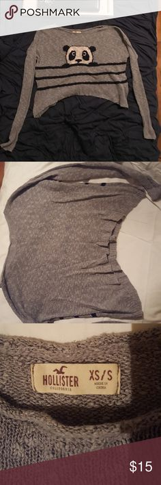 Hollister Panda Sweater Gray, long sleeve sweater by Hollister in a size xs/s and can fit bigger due to how flowy it is just the arms arms not as loose. Lightweight, cropped, shark bite style where it's longer on the sides, boatneck, 3 navy blue or black (hard to tell) lines on the front and a panda peeking out the top line. As seen on pretty little liars in season 5 on Aria Montgomery. Only washed and air dried to keep size from shrinking and shifting. Hollister Sweaters