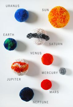 Make a fun and brightly coloured solar system mobile for your child's bedroom with pom poms.