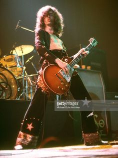 Jimmy Page of the rock band 'Led Zeppelin' performs onstage at the Forum on March 24, 1975 in Los Angeles, California.