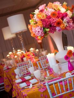 Hot Pink and Orange Wedding Inspiration love the table cloths! So many great pics of vibrant, exciting tropical color palates. Great for a tropical or tiki theme party, destination wedding, beach event, etc.