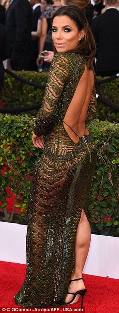Sheer daring: The 40-year-old left plenty of skin on show in a plunging and backless gown by Julien Macdonald, which also had mesh sections