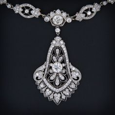 An absolutely stunning transitional style - late Edwardian / early Art Deco - platinum and diamond necklace signed Cartier. This magnificent treasure is accompanied by Cartier's original bill of sale from New York - dated January 18, 1929 - the height of Cartier's jewelry artistry. In the case of this particular piece, the necklace was evidently custom ordered by the original client (a single owner piece!) to compliment the client's beautiful bell shape diamond pendant (unsigned).