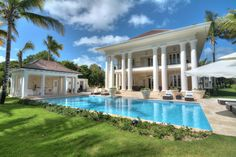 Luxury Caribbean estate villa at The Estates at Puntacana. Designed and constructed by Grupo Dupla, Dominican Republic.  #dominicanrepublicrealestate,  #luxuryrealestate, #luxuryhomebuilder, #design, #architech