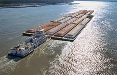 Towboats And Barges On The Mississippi by Garry McMichael