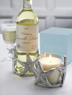 By the sea | so many pretty candle holders and some could house a bottle of wine at a party; clever