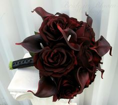 Deep plum calla Lillie's and black baccara roses