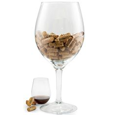 Store your corks in style with the Wine Enthusiast oversized wine glass cork holder. Fabricated from glass, it is designed to look like a giant wine glass. Standing an impressive 20 inches tall, this oversized glass holds hundreds of corks, and sparks endless conversations.