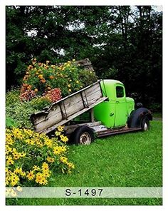 Dump truck planter- because we all have random dump trucks in our possession! (A large scale toy could work. Sunflower Garden, Flowers Garden, Flower Gardening, Garden Whimsy, Garden Planters, Flower Beds, Dream Garden, Yard Art, Garden Inspiration