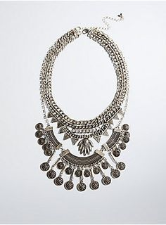 This statement necklace has us looking young, wild, and free. The chunky silver tone layered chains have boho babe vibes all over with coin charms, an etched bib, and triangle pendants.