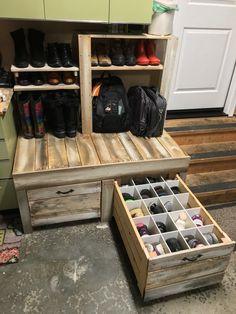 Shoe storage with bench. Drawers hide shoes and keep them from getting dusty in the garage. Pallet and scrap wood were used for the whole project. Paid less than $20 for wheels and cabinet pulls!!