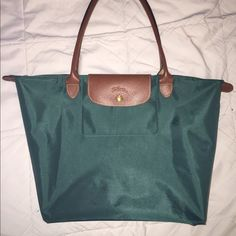 Longchamp le pliage in color CEDAR This color is CEDAR. 100000% authentic strictly purchased off longchamp.com. Please do contact before purchasing. This bag has been used ONCE. In perfect condition, absolutely no flaws. I prefer ️️ Longchamp Bags Totes