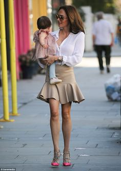 Glamorous: The Formula 1 heiress looked leggy in a puplum skirt and Valentino heels...