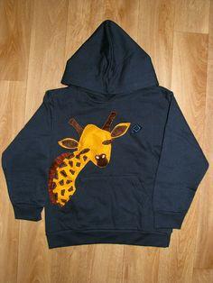Jersey con jirafa cosida. Tela y fieltro.