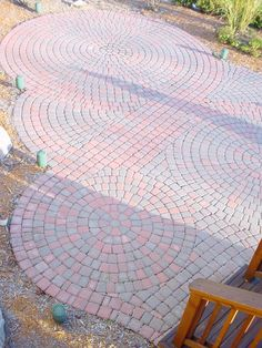 Circular pattern red brick paver patio in Northville Design and Creation by Frank Spiker
