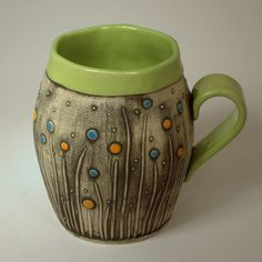 Mug built by hand. Features a lime green, orange and turquoise color combo and a modern floral design. Hand Built Pottery, Slab Pottery, Pottery Mugs, Ceramic Pottery, Clay Mugs, Ceramic Clay, Ceramic Bowls, Stars Disney, Inspiration Artistique