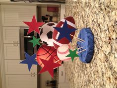 Sports Birthday Party - Cupcake Stand Topper - styrofoam circle covered with a napkin, balls and stars   added with bamboo skewers.