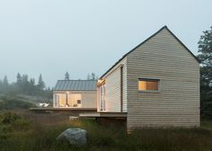Little House on the Ferry in Maine is formed of three wooden cabins, each linked by terraced decks
