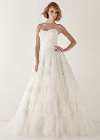 Turn fairy tale dreams into a sweet reality in this breathtaking wedding dress!  Strapless beaded lace ball gown with ultra-feminine sweetheart neckline.   Full tiered lace and tulle skirt adds flair, drama and dimension.  Fully lined. Back zip. Imported polyester. Dry clean only.  To preserve your wedding dreams, try our Wedding Gown Preservation Kit.