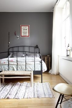 I like everything about this! Grey wall, pale wood floors. bright sun from the window...