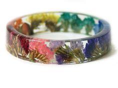 http://sosuperawesome.com/post/140589971543/real-flower-bracelets-by-modernflowerchild-on-etsy