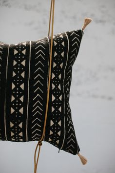 Image of limited edition | african mud cloth pillow with poms