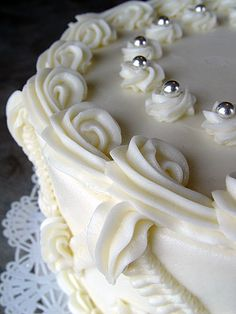 White cake soaked with amaretta syrup, filled with almond cream, iced with butter icing.
