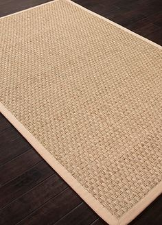 Add a warm accent to your home decor with this stylish Basket Weave rug. This durable casual area rug is made from natural sea grass with 100-percent cotton canvas backing. A fringeless color cotton border gives a clean, elegant look and feel.