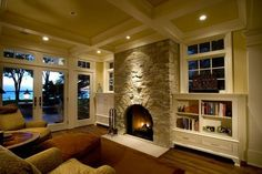 Beautiful stone fireplace, built-ins and coffered ceiling. (and the view) #cottagestyle www.HomeChannelTV.com
