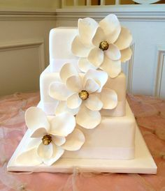Magnolia Wedding Cake, but I'd want a bigger cake to balance the large blossoms