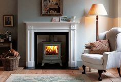 Winter warmer: The retro Alpine stove & traditional Clandon fireplace, both by Chesney's ...