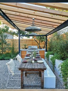 "Close Quarters  Mullins recommends a narrow table for outdoor dining, so she brought in this vintage find from the Bay Area's Elsie Green (elsiegreen.com). ""It keeps things intimate,"" she says, plus it makes passing plates easier. CB2's Victory Pendant Lights ($199; cb2.com), rustproof with a light industrial feel, encourage post-dinner chats well into the night. Mullins also installed inconspicuous outlets, so DuPree could work on her laptop without running out of juice."