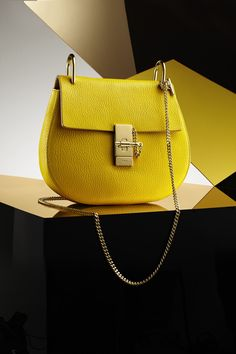 Brighten up your winter with Chloe's neon yellow leather Drew mini saddlebag. Available only at Bloomingdale's.