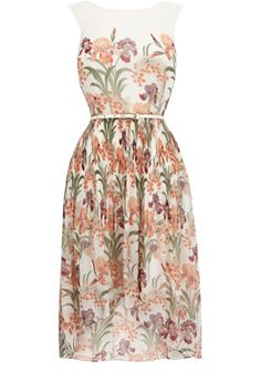 This dress has a dip hemline and an all over floral print. Sleeveless in style, this piece has a belted waist and a contrast cream border to the shoulders.
